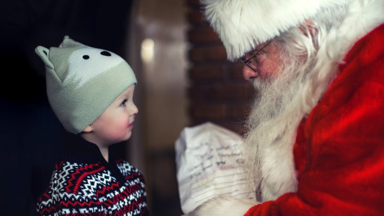 A picture of Santa with a child
