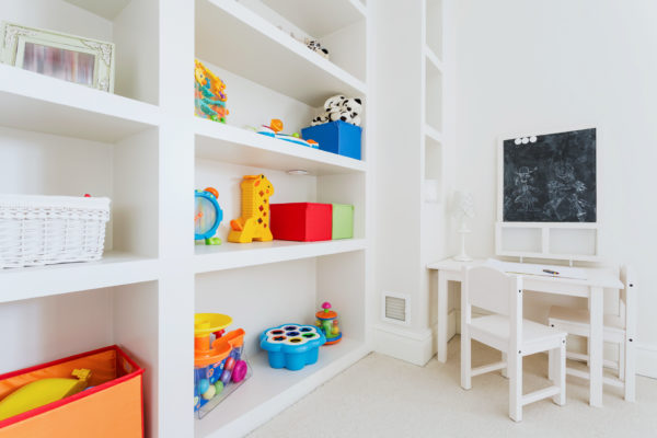 Zoom of white wooden furnitures in child room