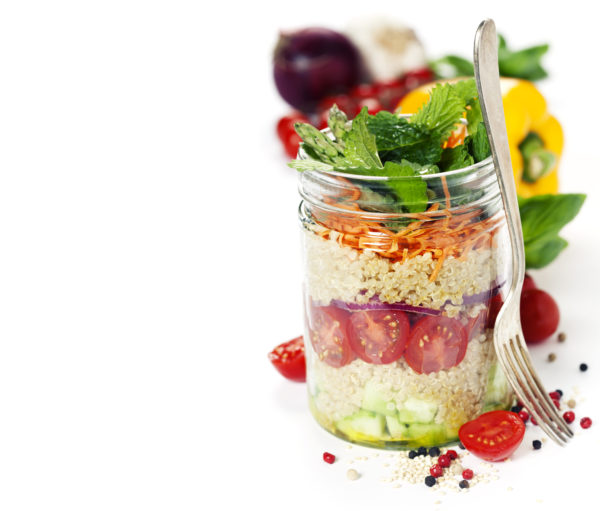 Cucumber, quinoa, tomato, onion, carrot and mint salad in a jar over whiteCucumber, quinoa, tomato, onion, carrot and mint salad in a jar over white