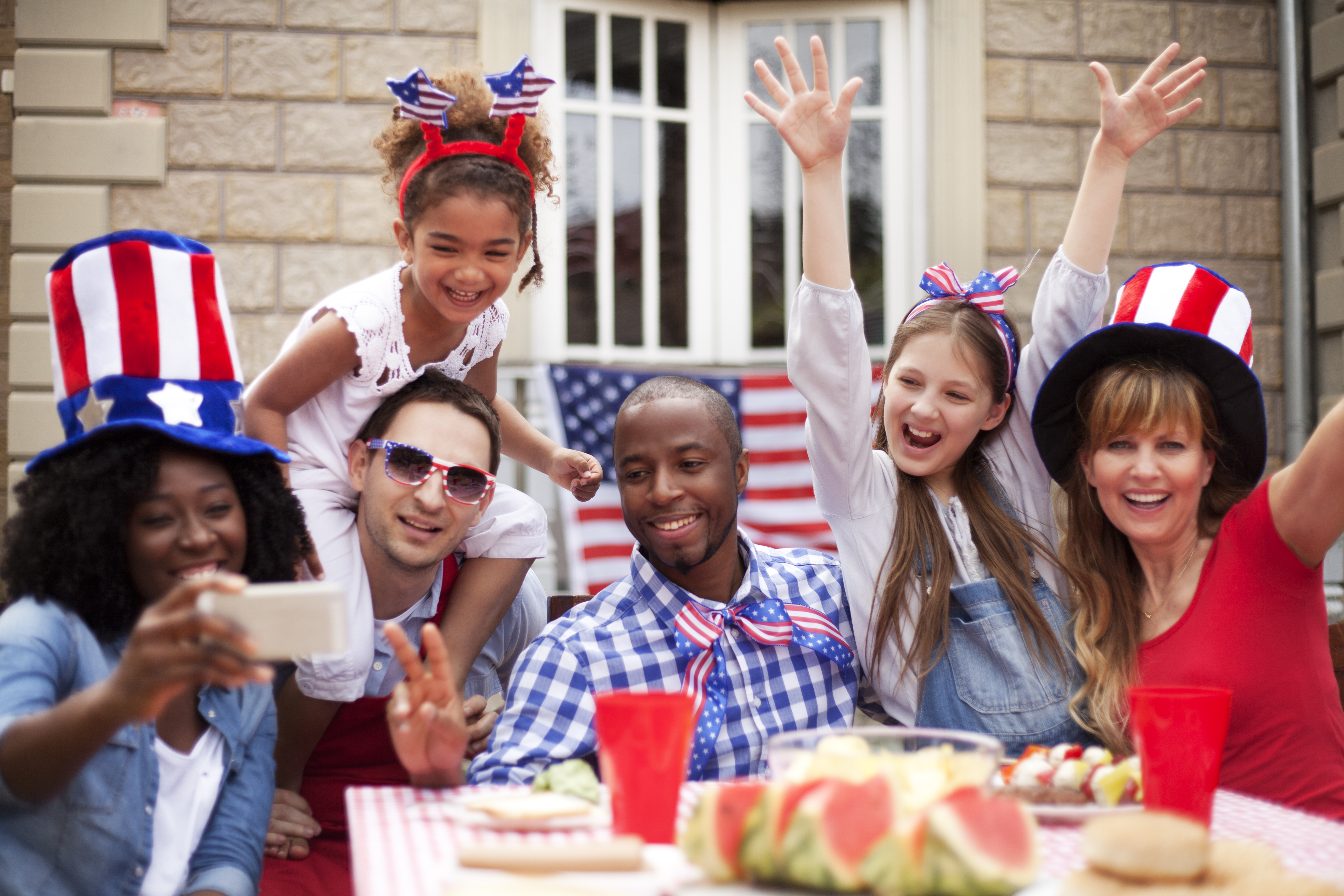Smiling friends having fun at their back yard on4th July. . They making selfie