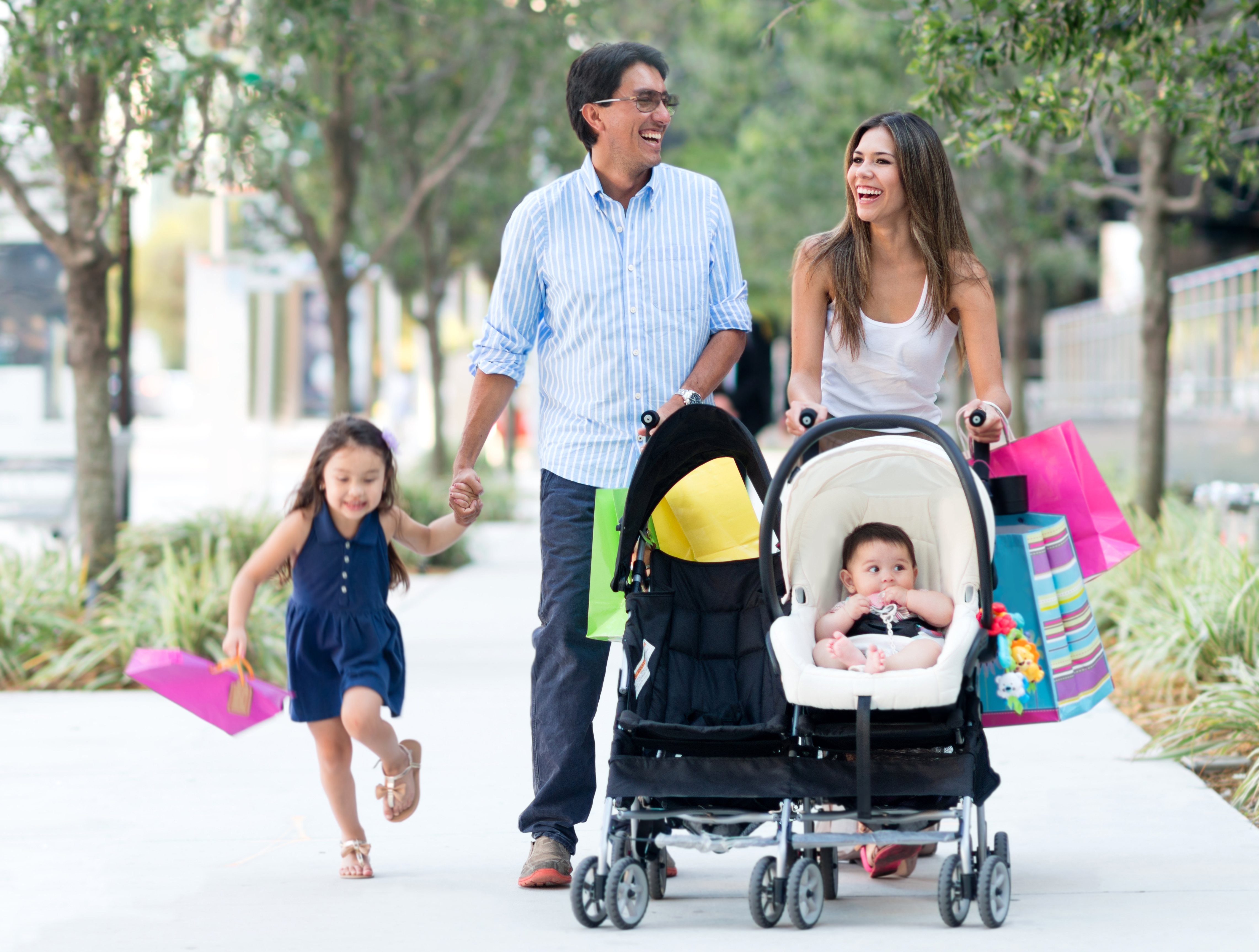 Family out shopping looking very happy