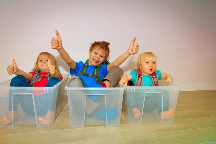 Kids playing with their new storage bins