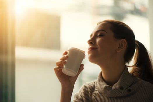 Woman happy with coffee
