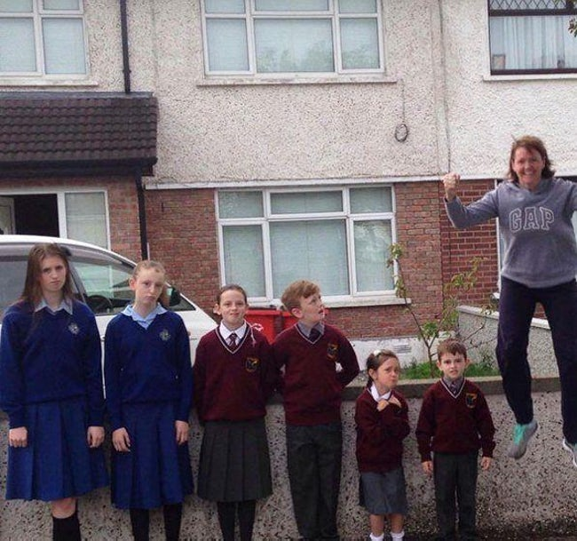 Back to school photos - joyful jumping mum
