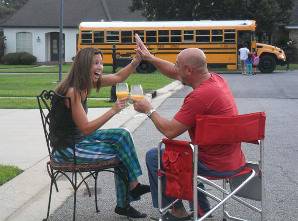 Back to school photos - happy parents, school bus