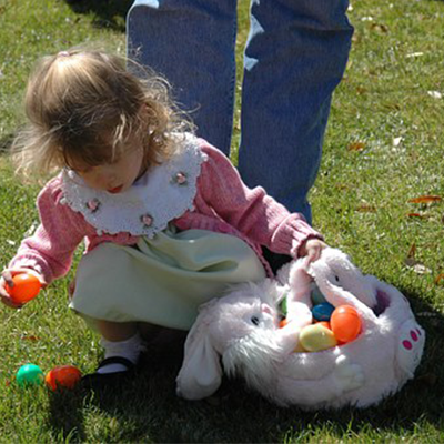 Easter egg hunt - Child collects eggs