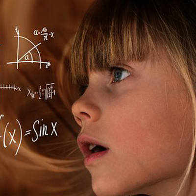 STEM - girl looking at maths equations