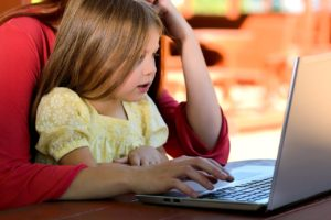 A picture of a mother and daughter using a computer