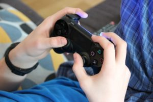 A picture of a child holding a video game controller
