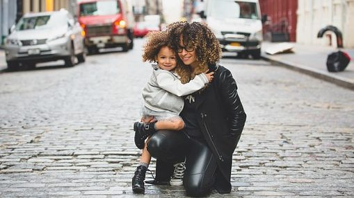 Picture of one child and mother in street