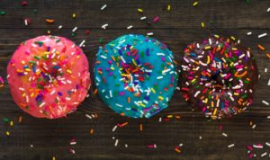 A picture of three doughnuts for doughnut day