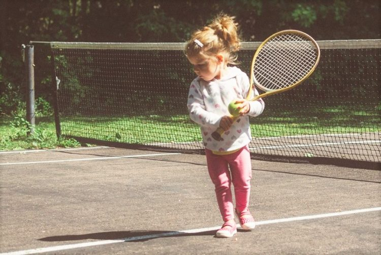 A picture of a young girl playing Tennis