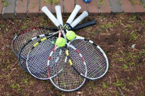 A picture of tennis racquets and tennis balls