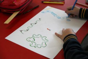 A picture of a child drawing.