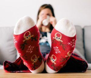 A picture of a woman with her feet up