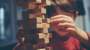 A picture of a child playing Jenga