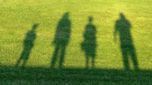 A picture of the shadows of a family watching sport