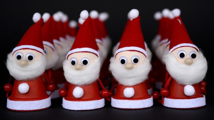 A picture of mini Santas made from creative kids' Christmas activities