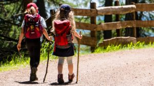 A picture of two girls walking to school
