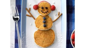 A picture of a banana pancake snowman
