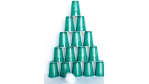 A picture of green cups stacked like a Christmas tree