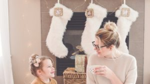 A picture of a mother and daughter at Christmas