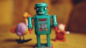 A picture of a green toy robot
