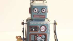 A picture of a grey toy robot