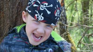 A picture of a child wearing pirate bandana