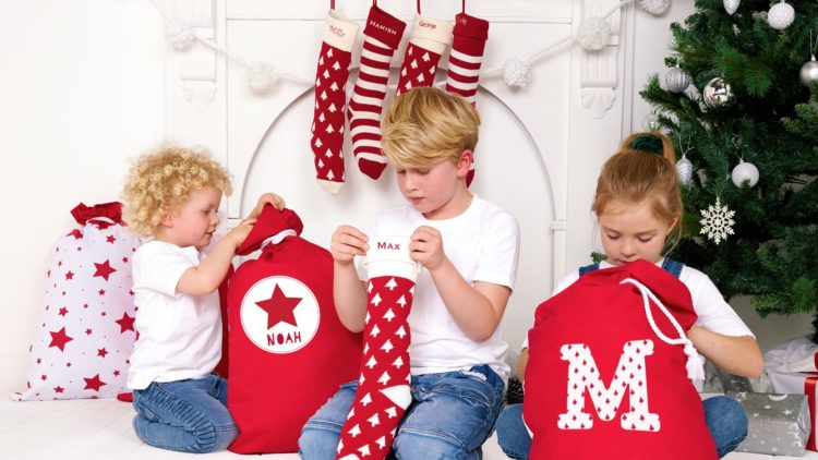 A picture of a family gathered around their Christmas stockings