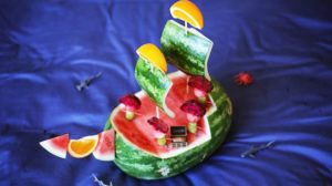 A picture of a watermelon made to look like a pirate ship