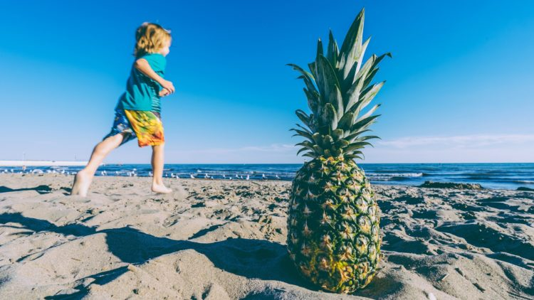 A child running on a beach to find beach recipes