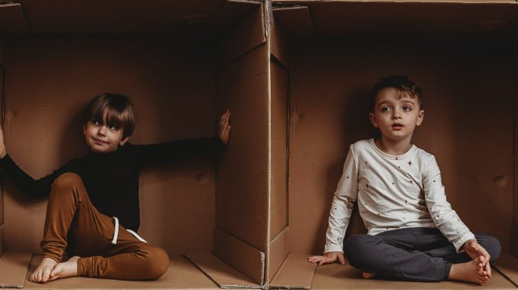 A picture of two kids in boxes for boxing day
