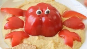 A picture of dip with a pepper crab