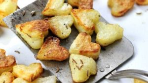 A picture of heart-shaped roast potatoes