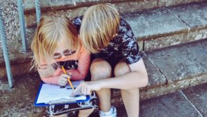 A picture of two children reading and learning