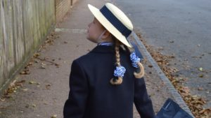 A picture of a child heading off for the first school day