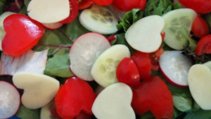 A picture of a heart-shaped salad