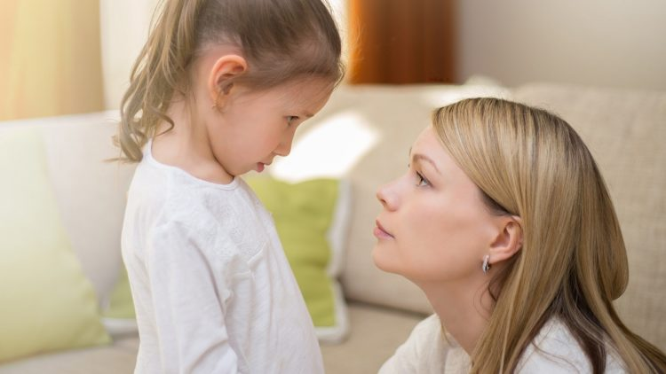 A picture of a mother talking to her child about coronavirus