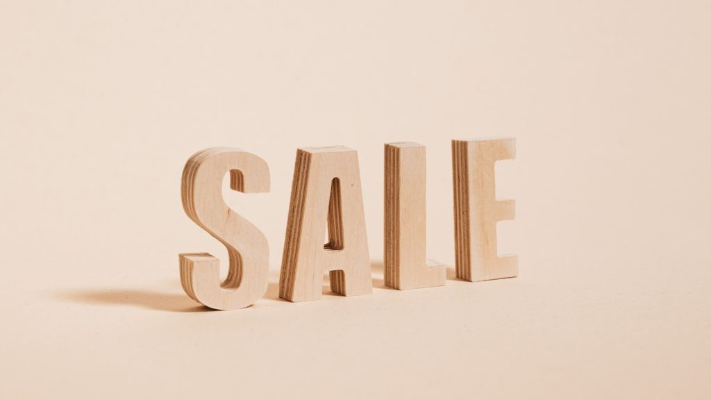 A picture of a cardboard sale sign